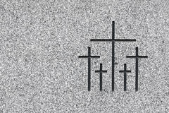 Crosses. Black and white picture of the group of crosses carved on grey stone. Plenty of space on the left to add text Royalty Free Stock Images