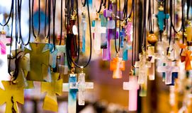Crosses. Several stone carved cross necklaces hanging on a rack. photo taken at the forks market in winnipeg, manitoba, canada Stock Image