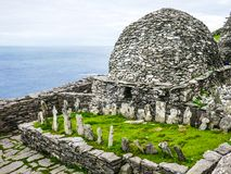 Wild Atlantic Way: Skellig Michael Monastery, The Monks` Graveyard and Large Oratory, constructed above the Atlantic Ocean. Crosses are believed to be in stock image