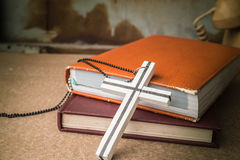 Crosses on a books Stock Images