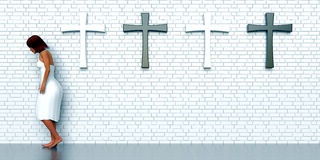 Crosses on brick wall Stock Image