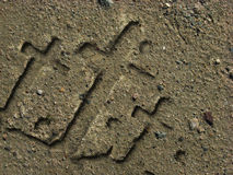 Crosses carved in the sand Royalty Free Stock Images