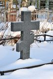 Crosses in a cemetery, monuments of the dead, a cemetery in winter, wreaths, artificial flowers. Russia.  stock photos