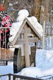 Crosses in a cemetery, monuments of the dead, a cemetery in winter, wreaths, artificial flowers. Russia.  stock photo