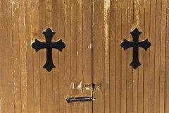 Crosses on church outbuilding doors Stock Photography