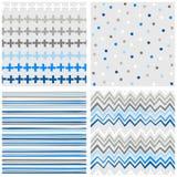 Crosses dots stripes and chevron blue seamless pattern set Royalty Free Stock Photos