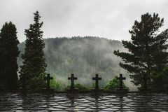 Crosses in the forest on a rainy day royalty free stock photos