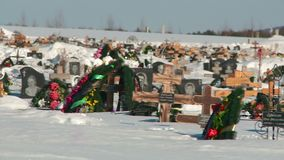 Crosses to the winter cemetery stock video footage