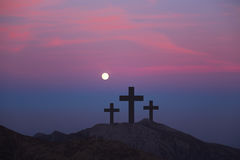Crosses on the hill over sunset backgroun.Religious concept of c Stock Images