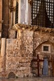 Crosses lean under an arch in the wall of the Church of the Holy Sepulcher in the Christian Quarter of the Old City of Jerusalem Stock Photo