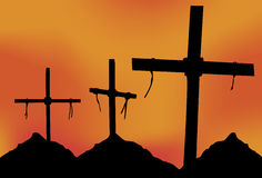 Crosses Mountain. Three Crosses in silhouette in front of a gray sky Stock Photos