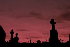 Crosses silhouettes against a cloudy sky Stock Images