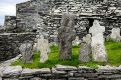 Wild Atlantic Way: Monks` remains marked by weatherworn crosses above Atlantic Ocean, Skellig Michael Monastery. The 22 crosses in the Skellig Michael Monks` royalty free stock photos
