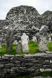 Wild Atlantic Way: Despite centuries of Wild Atlantic winters, the Monks` Graveyard crosses stand to inspire on Skellig Michael. The 22 crosses in the Skellig stock photography