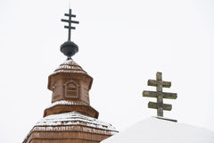 Crosses on top of Greek Catholic wooden church and belfry in Kalna Roztoka Stock Photo