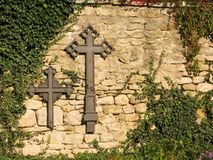 Crosses on the wall Stock Images