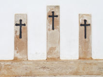 Crosses in a white wall Royalty Free Stock Images