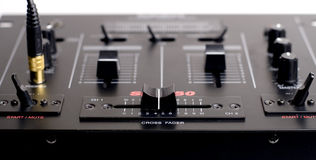 Crossfader. Closeup of the DJ crossfader/Mixer w/ headphones plugged in Royalty Free Stock Photo