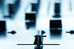 Crossfader on dj mixer in club Stock Photos