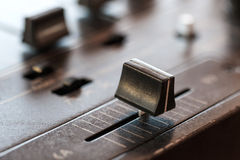 Crossfader on dj mixer in club Royalty Free Stock Images