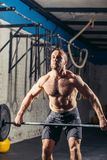 Crossfit athlete in the middle a heavy snatch lift in a cross-fit box gym Royalty Free Stock Images