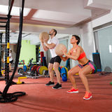 Crossfit ball fitness workout group woman and man. Crossfit ball fitness workout group women and men at gym Stock Photos