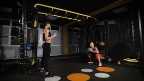 Crossfit ball fitness workout two woman