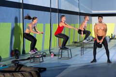 Crossfit box jump people group and kettlebell man Stock Image