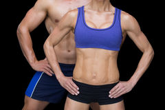 Crossfit couple posing with hands on hips Stock Photography