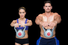 Crossfit couple posing with kettlebells Stock Image