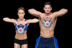 Crossfit couple posing with kettlebells Royalty Free Stock Photography