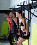 Crossfit dip ring group workout dipping in a row Stock Photos