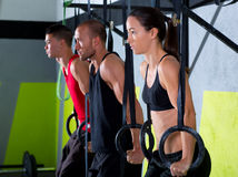 Crossfit dip ring group workout dipping in a row. Crossfit dip ring group workout at gym dipping in a row exercise royalty free stock photo