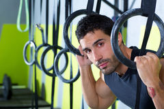 Crossfit dip ring man relaxed after workout at gym. Dipping exercise Royalty Free Stock Photo