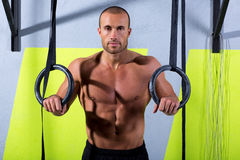 Crossfit dip ring man relaxed after workout at gym Stock Photo