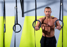 Crossfit dip ring man relaxed after workout at gym. Dipping exercise Royalty Free Stock Image