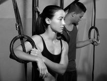 Crossfit dip ring man and woman relaxed after workout Royalty Free Stock Photos