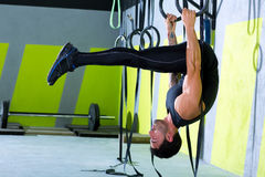 Crossfit dip ring man workout at gym. Dipping exercise Royalty Free Stock Images