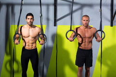 Crossfit dip ring two men workout at gym Stock Photo