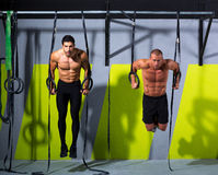 Crossfit dip ring two men workout at gym. Dipping exercise Royalty Free Stock Photo