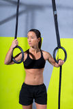 Crossfit dip ring woman relaxed after workout at gym Royalty Free Stock Images