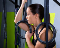 Crossfit dip ring woman relaxed after workout at gym Stock Image