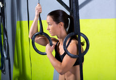 Crossfit dip ring woman relaxed after workout at gym Stock Images