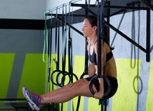 Crossfit dip ring woman workout at gym dipping. Exercise stock photography