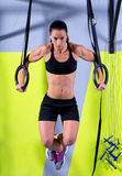 Crossfit dip ring woman workout at gym dipping. Exercise royalty free stock photos
