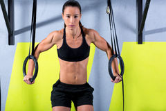 Crossfit dip ring woman workout at gym dipping Royalty Free Stock Photos