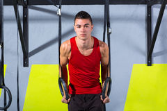 Crossfit dip ring young man workout at gym dipping Royalty Free Stock Photography