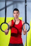Crossfit dip ring young manman relaxed after workout Stock Images
