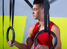 Crossfit dip ring young manman relaxed after workout Stock Photography