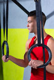 Crossfit dip ring young manman relaxed after workout Royalty Free Stock Photo